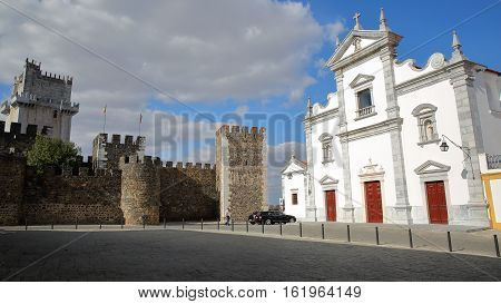 BEJA, PORTUGAL - OCTOBER 16, 2016: The Cathedral (Se) and the castle with the cobbled pavement in the foreground