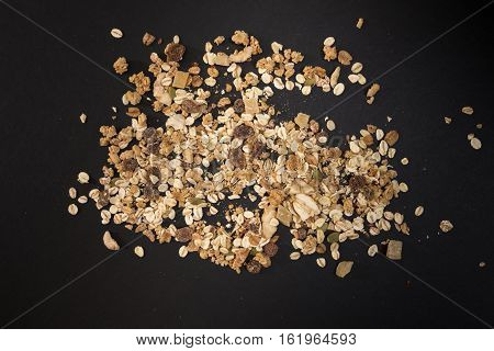 Muesli Heap With Dry Fruits, On Black  Background.
