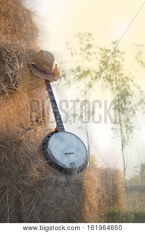 Banjo resting on straw Division in the fields the warm sun of farmers placed players relax after work.