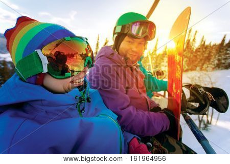 Group l snowboarders on the mountain resort