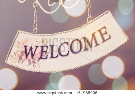 Selective Focus Of Welcome Sign Hanging On Ceiling, Sweet Tone.