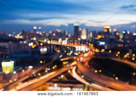 Abstract blurred lights city and road interchanged with twilight sky background