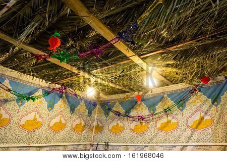 Fabric sukkah decorated with printed pattern and hebrew text of blessing: Grant peace everywhere goodness and blessing Grace lovingkindness and mercy to us and unto all Israel Your people. Night