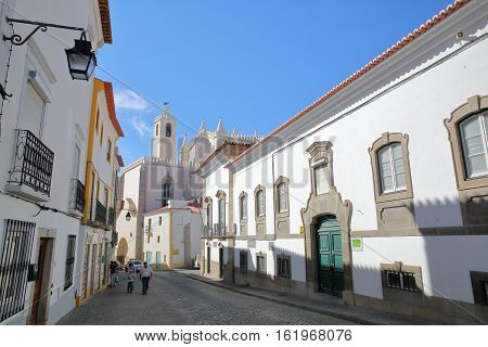 EVORA, PORTUGAL - OCTOBER 8, 2016: A cobbled street  with Sao Francisco Church in the background