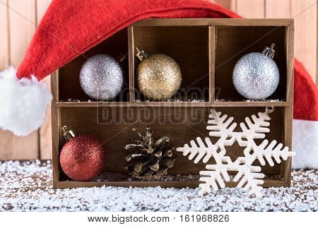 Christmas or New Year decoration with cones balls and Santa hat. Winter holidays Christmas or New Year concept.