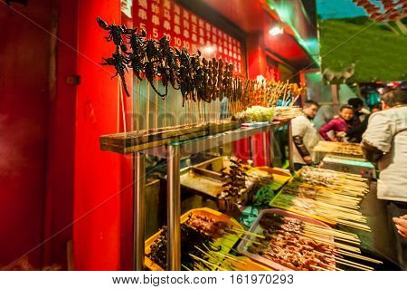 Beijing, China - Dec 06, 2011: Chinese Market, Fried Scorpions On Stick, Exotic Food Concept