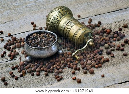 pepper pepperbox and pepper mill on a wooden table
