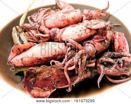Boiled squid with lemon grass menu in Thai restaurant