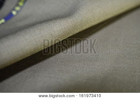 close up texture brown gold fabric of suit photo shoot by depth of field for object