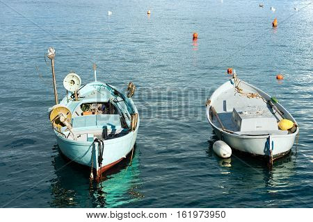 Two small rowing boats for fishing moored in the port of Portofino. Genova Liguria Italy