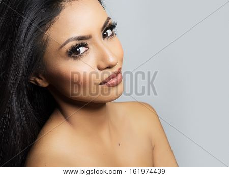 Beautiful woman's face and bare shoulders