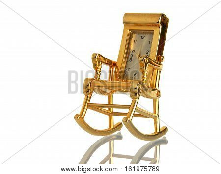 Armchair retro gilded clock with a mirror reflection isolated on a white background