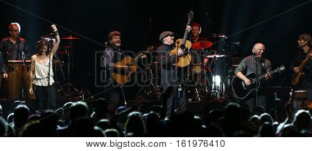 BROOKLYN, NY-DEC 9: Sarah McLachlan (L), James Taylor and Jimmy Buffett perform at WCBS-FM 101.1's Holiday in Brooklyn at Barclays Center on December 9, 2016 in Brooklyn, New York.