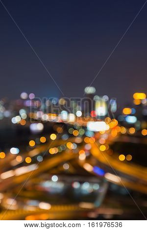 Night blurred lights city highway overpass interchanged, abstract background
