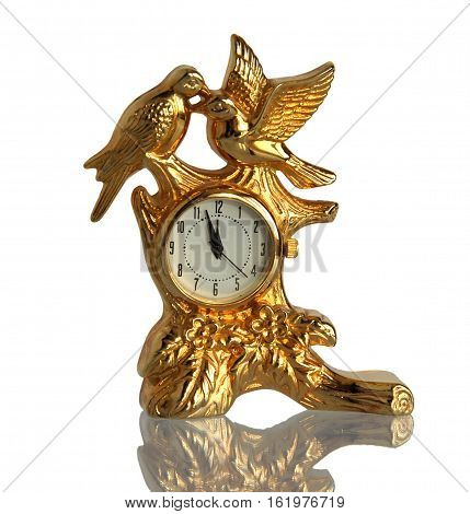 Birds retro gilded clock with a mirror reflection isolated on a white background