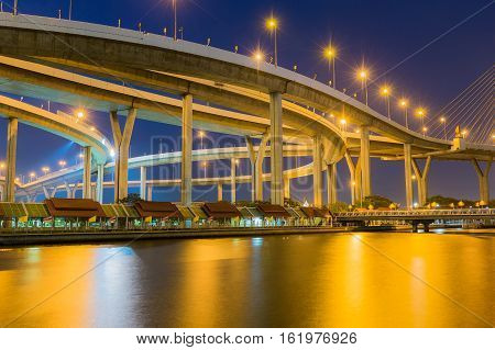 Highway overpass interchanged waterfront at twilight and reflection