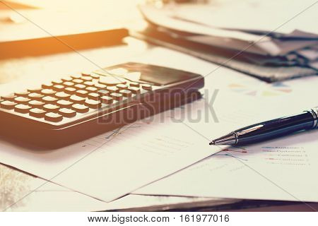 Close up business concept Pen on summary report and calculator on table office.