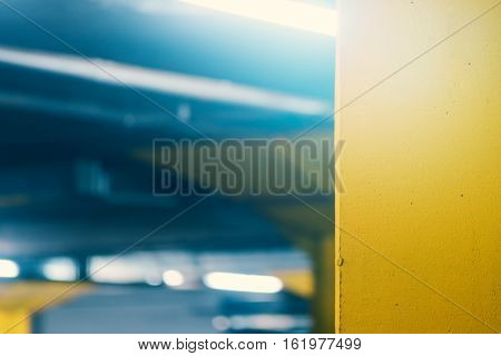 Underground garage parking lot blur abstract defocussed modern architecture detail for urban exploration background