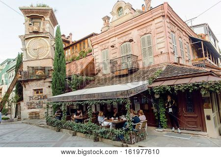 TBILISI, GEORGIA - SEP 25, 2016: People sitting at restaurant inside famous Rezo Gabriadze Marionette Theater on September 25, 2016. Tbilisi has population of 1.5 million people