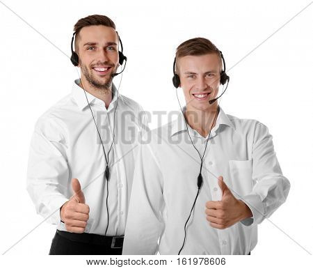 Young male technical support dispatchers on white background