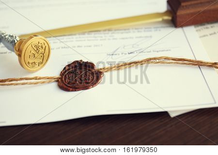 Old notarial wax seal and stamp, closeup