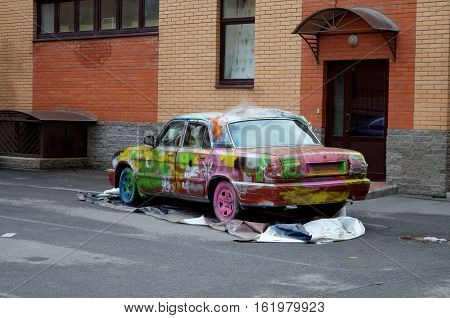 13.02.2016.Russia.Saint-Petersburg.the car was parked in the yard it was repainted in different colors.