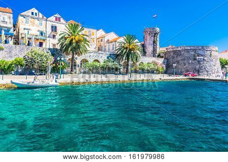 View at coastal town and promenade in place Korcula in Croatia, european travel destination.