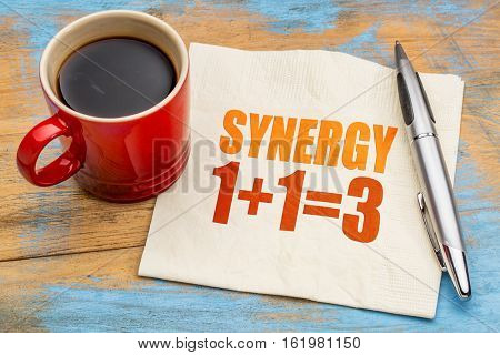 synergy concept - word abstract on a napkin with a cup of coffee