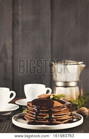 chocolate pancakes with chocolate sauce. coffee. breakfast