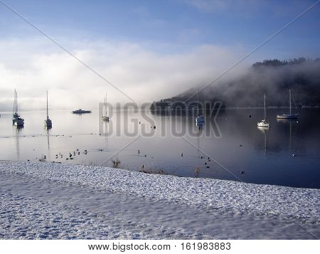 Windermere in Winter with snow and fog
