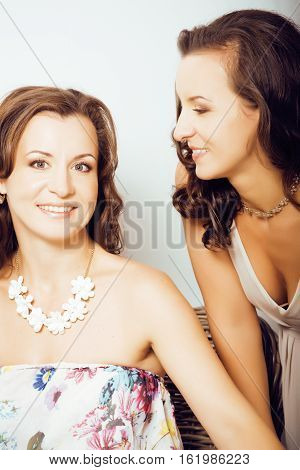 mature woman sisters twins at home interior, lifestyle people concept close up