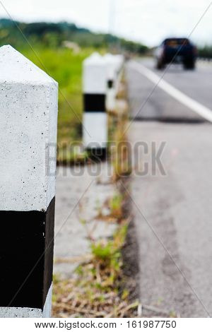 Pole black and white symbol at the roadside