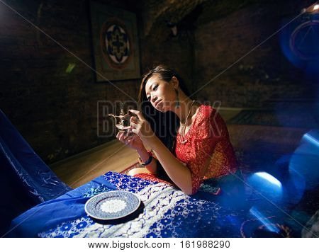 beautiful asian woman in oriental yoga indoor interior, fairy tale concept close up