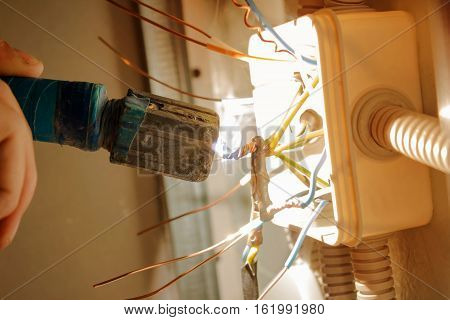 Soldering electrical wires in junction box. installation works