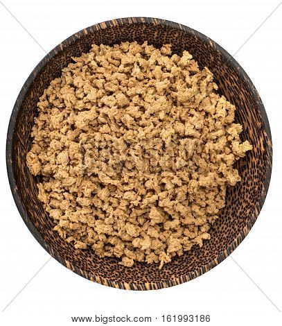 Eco food soy mince in a wooden bowl. Studio photo