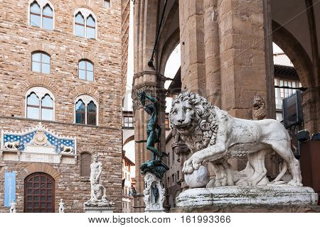 Medici Lion And Perseus Statues And Palazzo