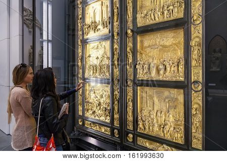 Visitors Near Original Gates Of Florence Cathedral