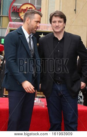 LOS ANGELES - DEC 15:  Ryan Reynolds, Nathan Fillion at the Ryan Reynolds Hollywood Walk of Fame Star Ceremony at the Hollywood & Highland on December 15, 2016 in Los Angeles, CA