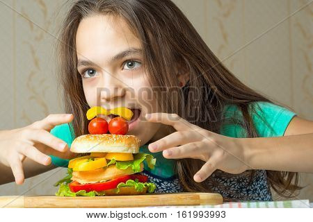 11 Year Old Girl Jumps On A Burger, The Concept Of Hunger And Unhealthy Eating Habits.