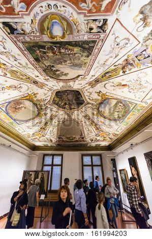 Visitors View Ceiling In Room In Uffizi Gallery
