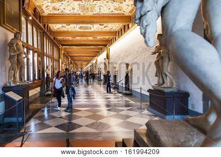 Tourists In Hallway Of Uffizi Gallery
