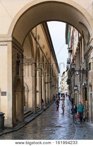 Tourists Near Vasari Corridor In Florence In Rain