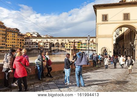 Tourists Near Vasari Corridor And Ponte Vecchio