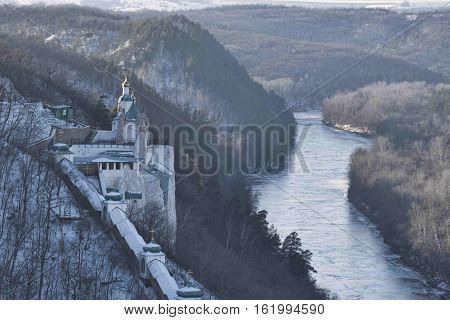 Siversky Donets River winter. On the left the Saint Nicolas Church of Sviatohirsk Lavra