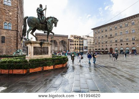 Monument Of Cosimo I And Tourists On Piazza