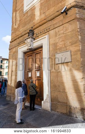 Tourists Near Doors Of Medici Chapel In Florence