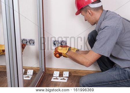 Electrician Installs Socket