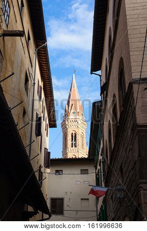 Bell Tower Over Old Street In Florence City