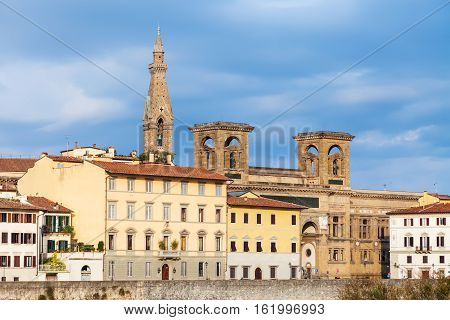 Houses On Quay And Towers Of Basilica Santa Croce