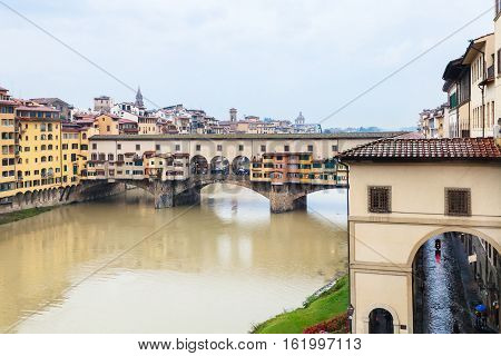 travel to Italy - view of Ponte Vecchio (Old bridge) and Arno river in Florence city in autumn rainy day poster